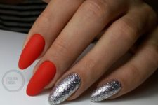 12 matte red nails and two silver leaf nails for a chic holiday manicure