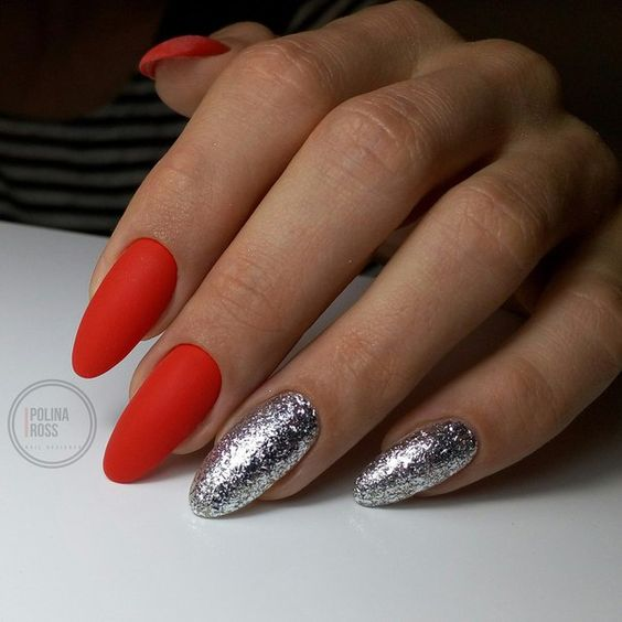matte red nails and two silver leaf nails for a chic holiday manicure