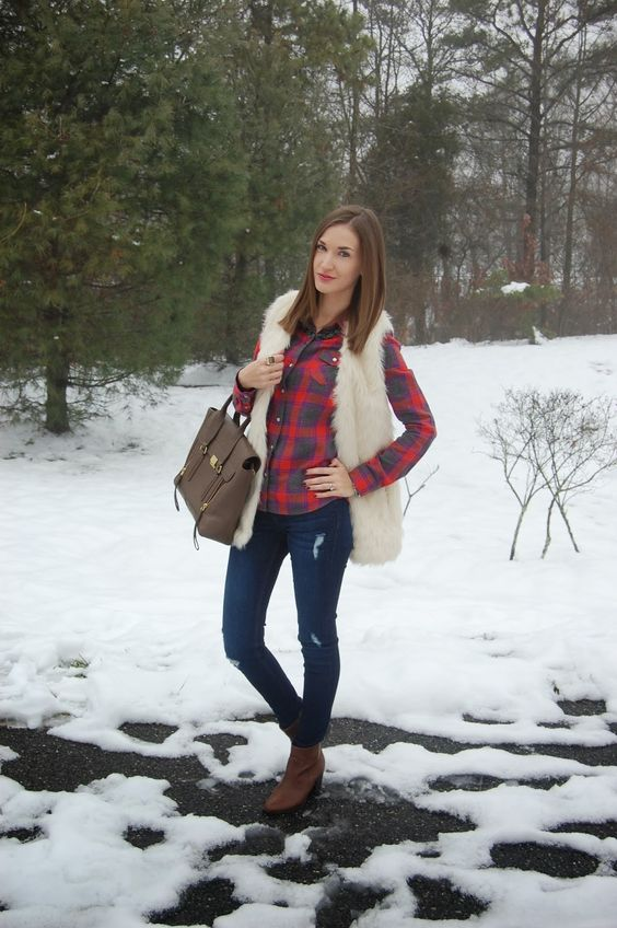 navy jeans, a plaid shirt, a creamy vest, brown booties