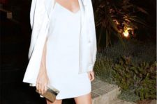 13 a white slip mini dress with a white blazer over it, black ankle strap shoes and a metallic clutch