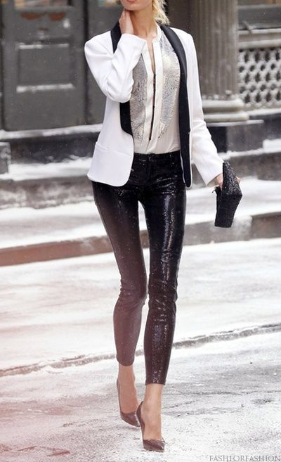 a zip shirt, a white and black jacket, black sequin pants and a matching clutch