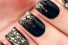 13 black nails with gold leaf and a gold leaf accent nail for New Year's Eve