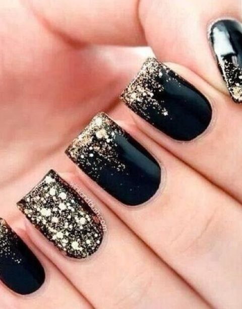 black nails with gold leaf and a gold leaf accent nail for New Year's Eve