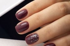 13 burgundy manicure with silver glitter and rhinestones for a gorgeous touch