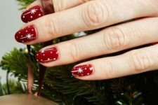 13 red celestial nails with polka dots are a timeless idea