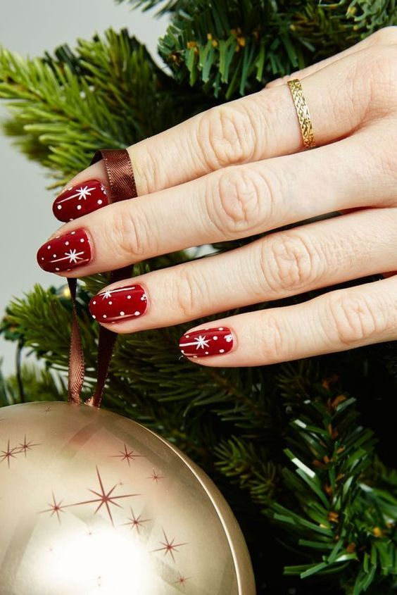 red celestial nails with polka dots are a timeless idea