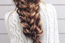 14 a large voluminous braid made of several braids on long hair looks just jaw-dropping
