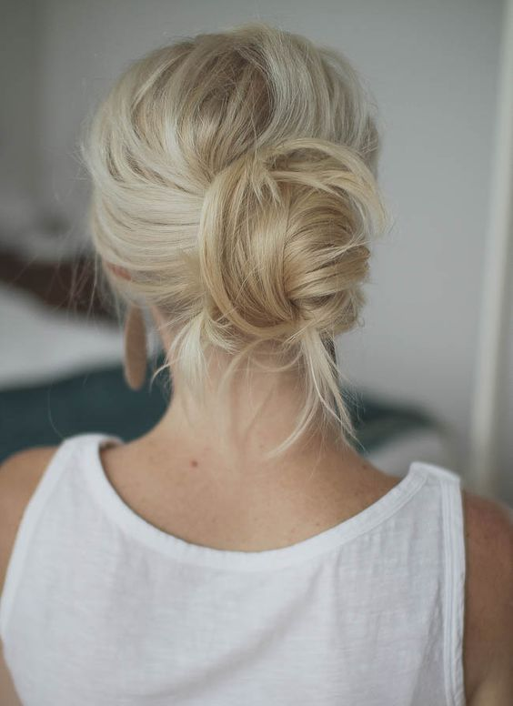 a messy twisted low bun will take just 1 minute to make