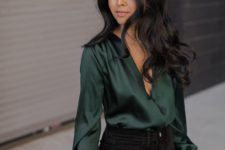 14 black skinnies and a dark green blouse with a plunging neckline is all you need to look amazing