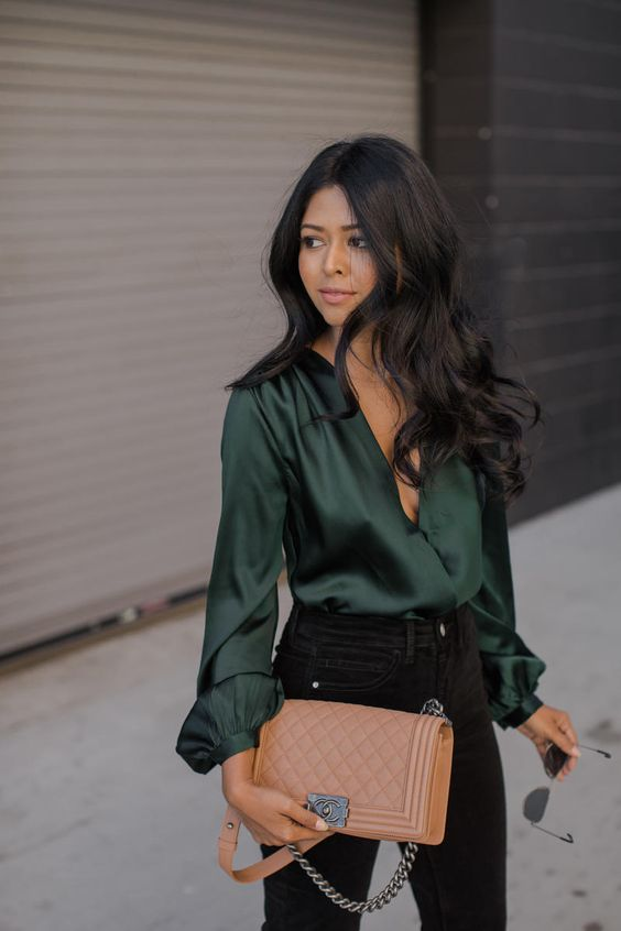 black skinnies and a dark green blouse with a plunging neckline is all you need to look amazing