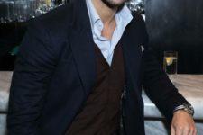 14 grey pants, a brown waistcoat, a blue shirt and a navy blazer
