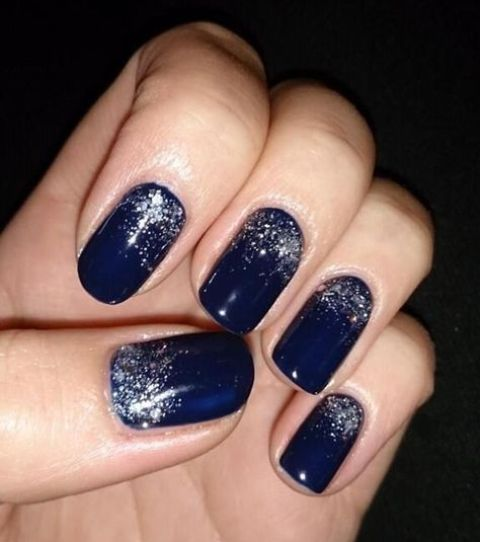 navy nails with silver glitter touches look bold and festive