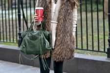 14 navy skinnies, a neutral sweater, a long fur vest and brown boots