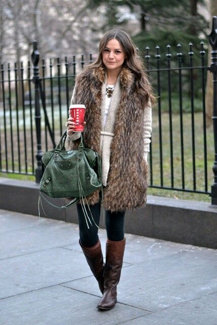 navy skinnies, a neutral sweater, a long fur vest and brown boots