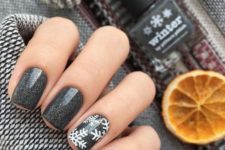 15 black glitter nails with some snowflakes look very chic