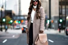 15 black ripped jeans, a creamy cutout sweater, a blush coat and black boots