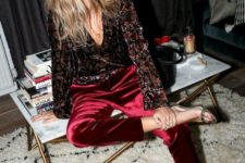 15 burgundy velvet pants, a vintage-inspired floral blouse and metallic shoes