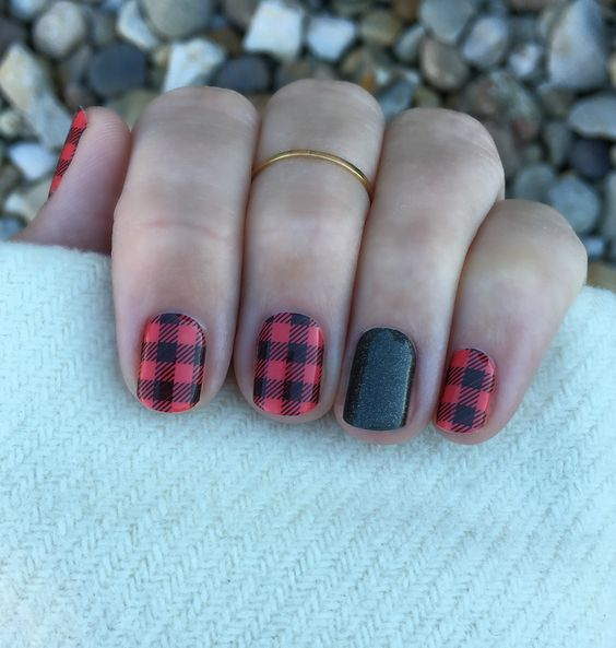 plaid flannel manicure with a green glitter accent finger
