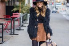 15 tall suede boots, a rust mini skirt, a faux fur vest and a black turtleneck