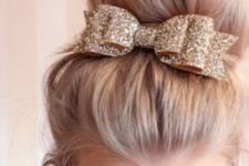 16 a top knot with a glitter bow looks very glam-like and cute