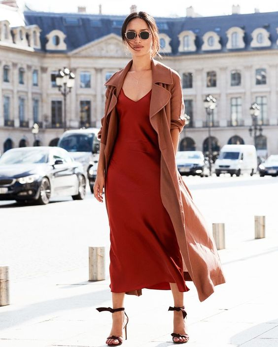fiery red-colored silk slip dress, ankle bow shoes and a trench coat to stand out