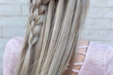 16 long hair with a diagonal waterfall braid is a chic and romantic option