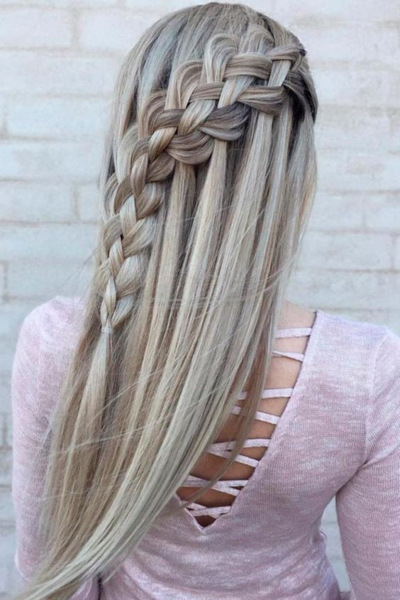 long hair with a diagonal waterfall braid is a chic and romantic option