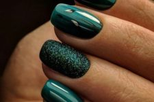 16 shiny forest green nails with a glitter accent one for holidays