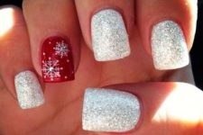 17 silver glitter nails with an accent red one with snowflakes