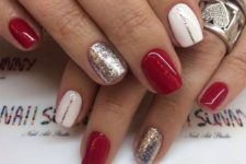 20 red manicure with silver glitter and white accents