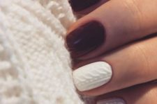22 burgundy and white cable knit nails create a bold contrast and a cozy look