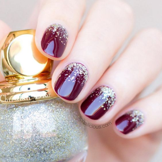 burgundy nails with gold glitter look chic and stylish