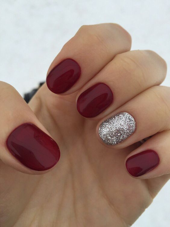 red nails with an accent silver glitter one is classics for all times