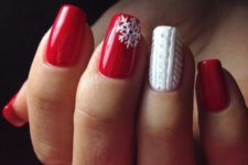 31 red manicure with a snowflake accent and a white cable knit accent nail
