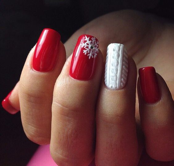 red manicure with a snowflake accent and a white cable knit accent nail