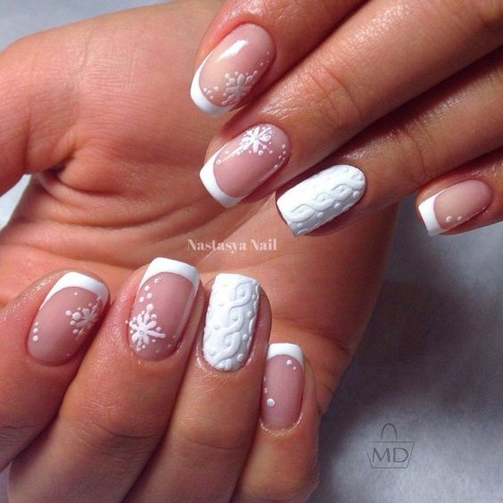 French manicure with snowflaks and cable knit accent nails look chic and unusual