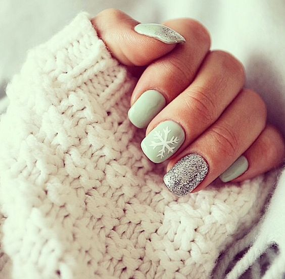 neutral dove grey manicure with a glitter nail and a snowflake