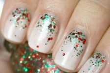 36 neutral nails with red, gold and emerald glitter on top