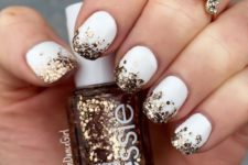 39 white nails with gold glitter hexagons for a chic glam look