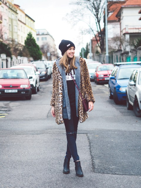 With beanie, distressed jeans, ankle boots, marsala bag and blue cardigan