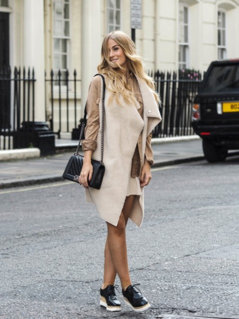 With beige dress, platform shoes and black bag