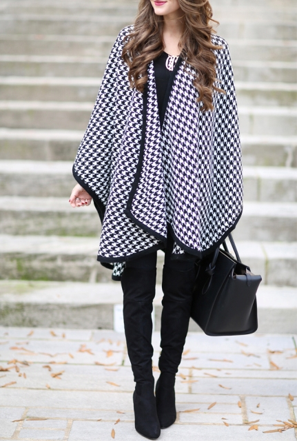 With black blouse, boots, pants and leather bag