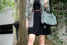 With black dress, gray cardigan, olive green jacket, printed scarf and bag