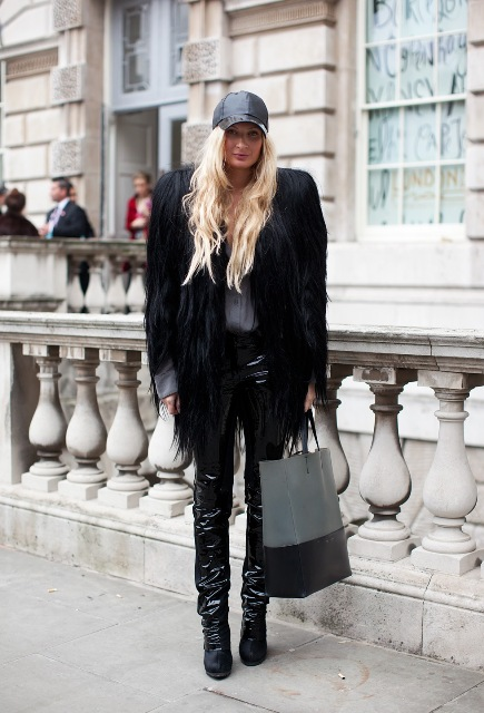With black fur coat, leather pants and two color tote