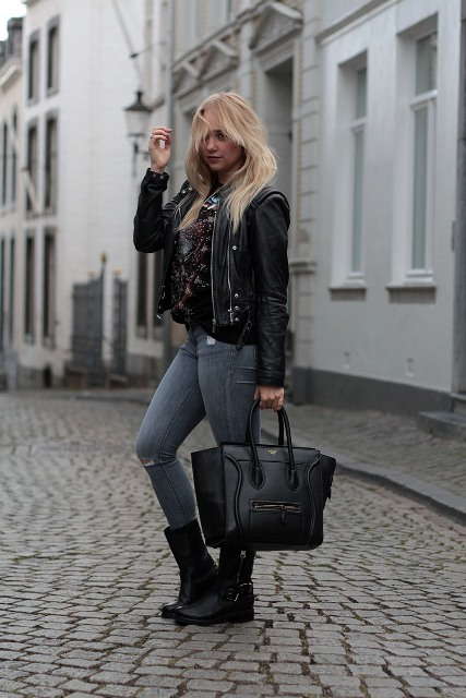 With black jacket, jeans and black tote