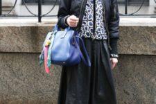 With black jacket, printed jacket, midi skirt, mid calf boots and blue bag