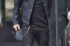 With black jeans, black t-shirt, brown shoes and cap