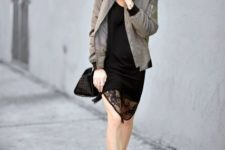 With black lace dress, ankle boots, bomber jacket and black bag