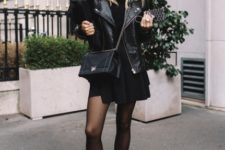 With black leather jacket, chain strap bag, mini dress and black tights