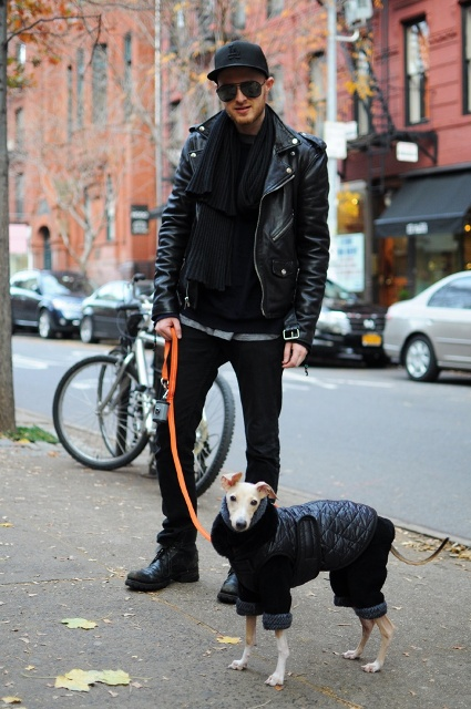 With black leather jacket, pants, boots and scarf